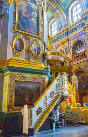 POCHAYIV, UKRAINE - AUGUST 30, 2017: The pulpit of Dormition Cathedral decorated with golden bas reliefs,  on August 30 in Pochayiv. Editorial