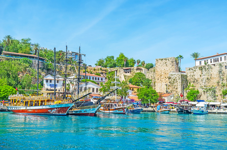 ANTALYA, TURKEY - MAY 12, 2017: The scenic old marina of resort with yachts, pleasure boats and replicas of medieval galleons, ready for the daily trips on May 12 in Antalya. Editorial