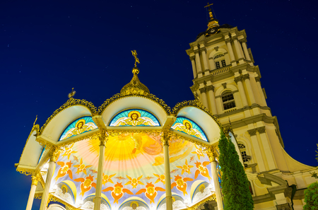 POCHAYIV, UKRAINE - AUGUST 29, 2017: The view on beautiful Summer Altar and Bell Tower of Pochaev Lavra in bright illumination, on August 29 in Pochayiv. Фото со стока