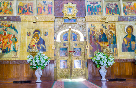 POCHAYIV, UKRAINE - AUGUST 30, 2017: The golden Royal doors in iconostasys of Holy Trinity Cathedral, on August 30 in Pochayiv.