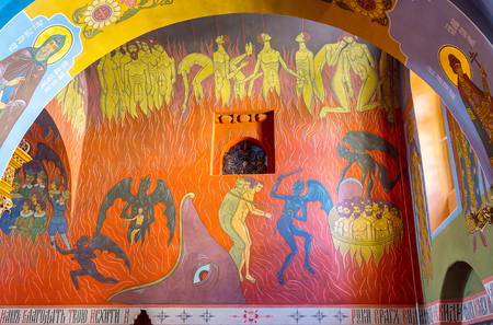 POCHAYIV, UKRAINE - AUGUST 30, 2017: The interior of Holy Trinity Cathedral boasts beautiful frescoes depict hell with punishment of sinners, on August 30 in Pochayiv.