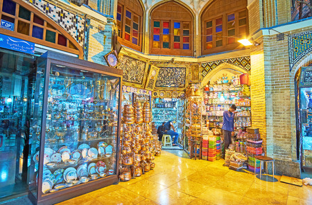 TEHRAN, IRAN - OCTOBER 11, 2017: The  stalls with porcelain and copper cookware in Timcheh-e Hajeb-od-Dowleh courtyard of Grand Bazaar, on October 11 in Tehran. Editorial
