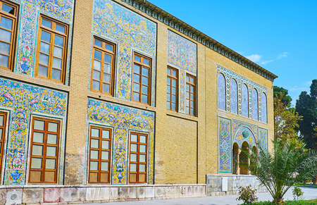 The wall of Golestan Palace with scenic Persian patterns, covering the glazed tiles, Tehran, Iran.