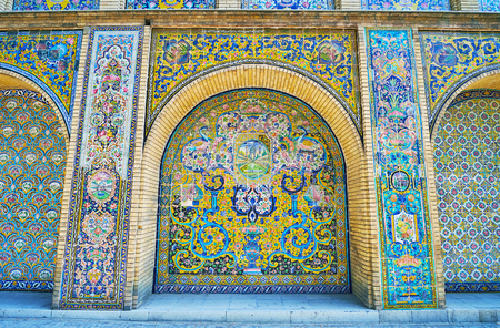 TEHRAN, IRAN - OCTOBER 11, 2017: The Edifice of Sun (Shams-ol-Emareh) in Golestan palace complex boasts outstanding tiled decors of the long arched wall, on October 11 in Tehran.