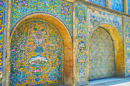 TEHRAN, IRAN - OCTOBER 11, 2017: The exteriors of Golestan Palace are famous for the splendor tiled patterns and pictures in traditional Persian style, on October 11 in Tehran.