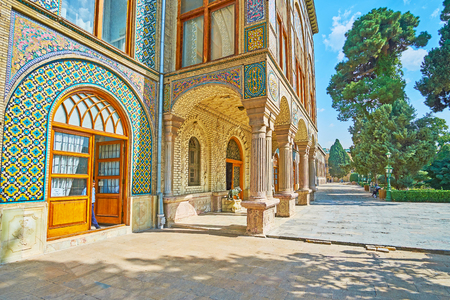 TEHRAN, IRAN - OCTOBER 11, 2017: The  scenic entrance to Main Halls of Golestan Palace, decorated with stone columns, tiled and relief brick ornaments, on October 11 in Tehran.