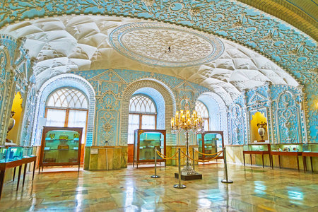 TEHRAN, IRAN - OCTOBER 11, 2017: Interior of Muz-e Makhsus (Special Museum), also famous as Museum of Gifts of Golestan Palace with Eastern carved patterns on walls and ceiling, on October 11 in Tehran.