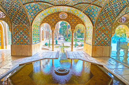 TEHRAN, IRAN - OCTOBER 11, 2017: The fountain in Karim Khani Nook of Golestan was created to provide freshness and coolness to this summer pavilion, on October 11 in Tehran.