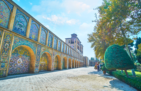 TEHRAN, IRAN - OCTOBER 11, 2017: The walk along the multiple arches of Shams-ol-Emareh (Edifice of Sun) of Golestan Palace, covered with intricate tile patterns, on October 11 in Tehran.