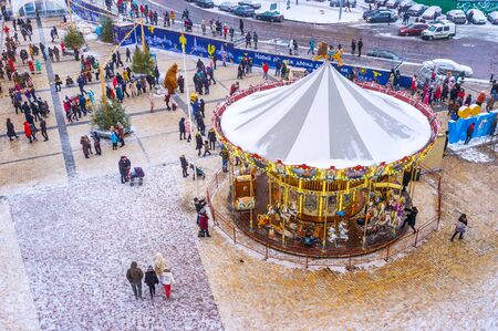 KIEV, UKRAINE - JANUARY 4, 2017: Christmas Fair is a very popular among locals due to variety of amusements for kids, such as carousels and street actors dressed in different costumes, on January 4 in Kiev. Editorial
