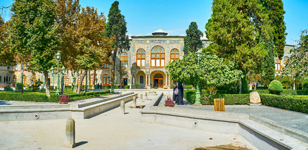 TEHRAN, IRAN - OCTOBER 11, 2017: Golestan garden is the perfect place to overlook the picturesque palace, enjoy the nature and relax in shade, on October 11 in Tehran.