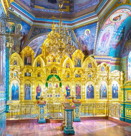 POCHAYIV, UKRAINE - AUGUST 30, 2017: Beautiful wooden carved iconostasis of Holy Spirit Church of Holy Spirit Skete, on August 30 in Pochayiv. Editorial