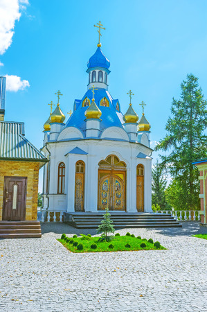 The small chapel with wooden carved doors located on the territory of Holy Spirit Skete in Pochaev, Ukraine