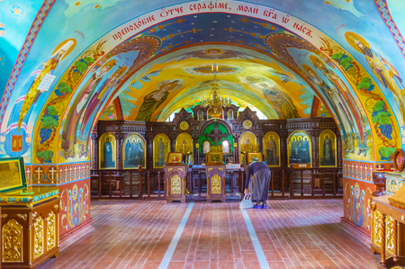 POCHAYIV, UKRAINE - AUGUST 30, 2017: Beautiful colorful interior of St. Seraphis of Sarov Church decorated with beautiful frescoes on its walls and ceilings, on August 30 in Pochayiv.