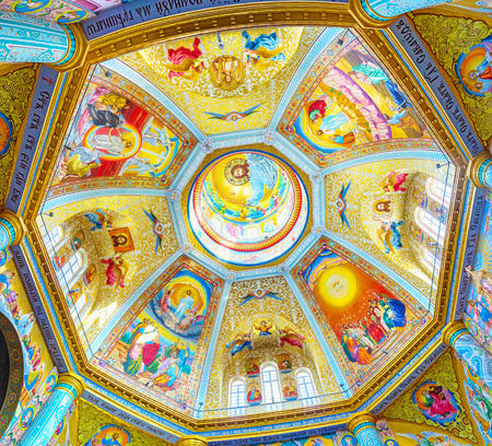 POCHAYIV, UKRAINE - AUGUST 30, 2017: Huge cupola of Transfiguration Cathedral decorated with beautiful colorful mosaic, on August 30 in Pochayiv.