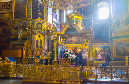POCHAYIV, UKRAINE - AUGUST 30, 2017: Bower parishioners before the icon of Dormition of Virgin Mary inside Dormition Cathedral in Pochayiv Lavra, on August 30 in Pochayiv.