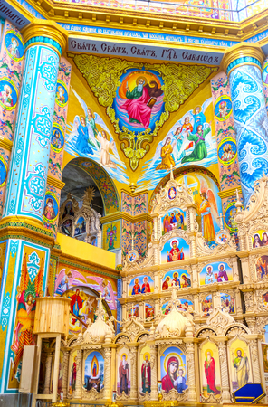 POCHAYIV, UKRAINE - AUGUST 30, 2017:  Impressive bright frescoes and mosaics of interior of Transfiguration Cathedral, on August 30 in Pochayiv. Redakční