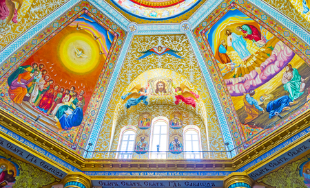 POCHAYIV, UKRAINE - AUGUST 30, 2017: The view on beautiful mosaics of Transfiguration Cathedral depicts the scenes of Holy Bible, on August 30 in Pochayiv.
