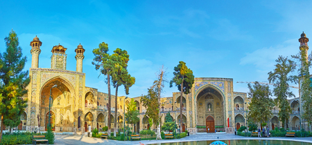 TEHRAN, IRAN - OCTOBER 11, 2017: The courtyard of medieval complex of Sepahsalar (Shahid Motahari) mosque and madrasa with rich decorated portals and green garden, on October 11 in Tehran. 에디토리얼