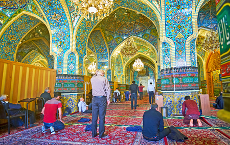 TEHRAN, IRAN - OCTOBER 11, 2017: The prayer hall of the Shahs Mosque with many columns, arched construction and tiled patterns, on October 11 in Tehran. Editorial