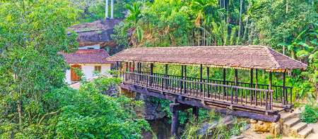 Panorama of the ancient Bogoda Wooden Bridge across Gallanda Oya river in mountains of Ketawala, Sri Lanka. Stock Photo
