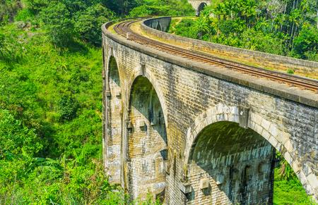 Demodara boasts the unique fusion of British railway architecture and Sri Lankan nature, making Nine Arch Bridge interesting location for tourists, Ella. Stock Photo