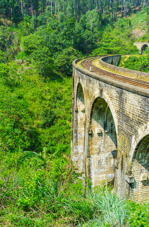 Nine Arch Bridge is the popular destination among the admirers of agritourism,  Demodara is rich in scenic tea plantations, gardens and jungle, Ella, Sri Lanka. Stock Photo