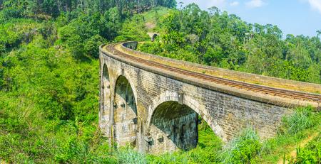 Panorama of the bend of Nine Arch Bridge in Demodara and the lush forest around it, Ella, Sri Lanka. Stock Photo