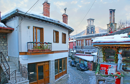 METSOVO, GREECE - JANUARY 2, 2012: The small Vlach town is the popular tourist resort in Pindus mountains, famous for its architecture and cuisine, on January 2 in Metsovo.