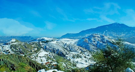 The scenic Pindus mountain range, covered with pure white snow, Trikala, Greece.