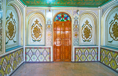 SHIRAZ, IRAN - OCTOBER 12, 2017: The chamber of Qavam (Ghavam) House in Naranjestan complex is decorated with paintings and floral patterns, on October 12 in Shiraz.