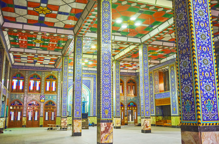 YAZD, IRAN - OCTOBER 17, 2017: Modern interior of Hazayer Mosque boasts colorful tiles and stained glass windows, on October 17 in Yazd