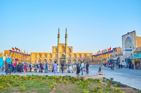 YAZD, IRAN - OCTOBER 17, 2017: Amir Chakhmaq square is the most photogenic place in the city that attracts tourists and locals, on October 17 in Yazd