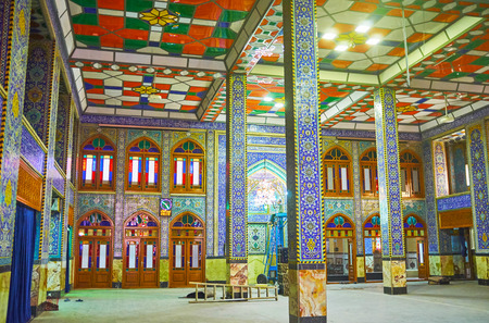 YAZD, IRAN - OCTOBER 17, 2017: Walls and columns of Hazayer Mosque are decorated with tiles with traditional persian patterns, on October 17 in Yazd
