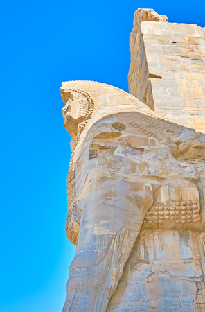 The ruins of the giant bull statue, guarding the western entrance to the All Nations Gate (Xerxes Gate) of Persepolis archaeological site, Iran. Stock Photo