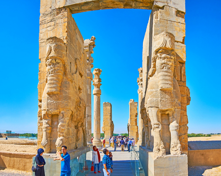 PERSEPOLIS, IRAN - OCTOBER 13, 2017: The giant Lamassu statues (Assyrian deity) decorate the eastern entrance to All Nations Gate (Xerxes Gate) in Persepolis archaeological site, on October 13 in Persepolis.