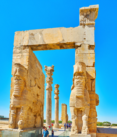 PERSEPOLIS, IRAN - OCTOBER 13, 2017: Two huge Lamassu  (Assyrian deity) protect the entrance to All Nations Gate (Xerxes Gate) in Persepolis archaeological site, on October 13 in Persepolis.