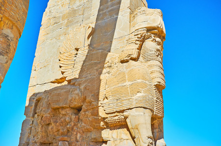 The giant statue of Lamassu (Assyrian deity) is the part of the eastern wall of the All Nations Gate (Xerxes Gate) in Persepolis archaeological site, Iran.