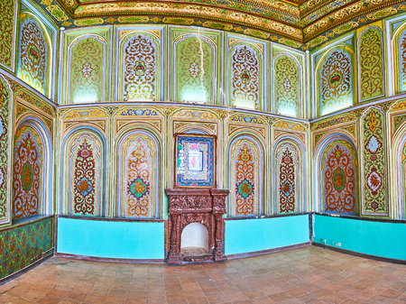 SHIRAZ, IRAN - OCTOBER 12, 2017: The picturesque interior of Qavam House of Naranjestan complex, painted floral traceries cover the walls and ceiling, on October 12 in Shiraz. Editorial