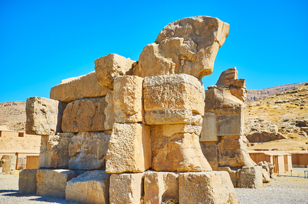 The ruins of Unfinished Gate with bad preserved horse protome on the top, Persepolis, Iran.