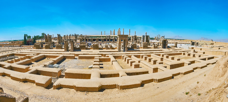 Rahmet Mount opens great view on the ruins of ancient Persepolis with its gates and columns, Iran.