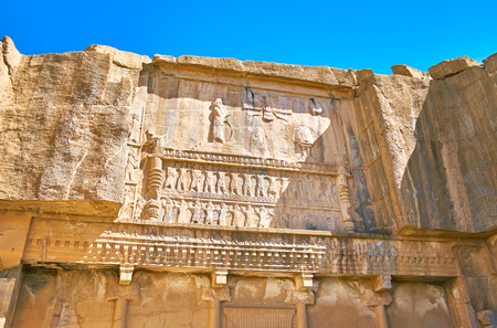 The ancient carvings on the facade of cut in rock Tomb of Artaxerxes III, Persepolis, Iran. Stock Photo