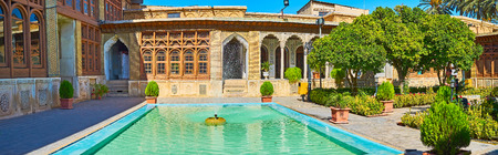 SHIRAZ, IRAN - OCTOBER 12, 2017: The  fountain is one of the main objects of traditional Persian mansion, such as Zinat Ol-Molk, on October 12 in Shiraz.