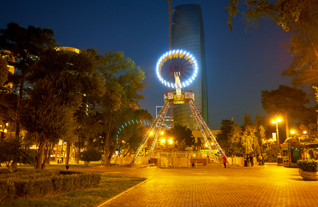 BAKU, AZERBAIJAN - OCTOBER 9, 2017: Amusement Park with bright illumination is a very popular place in the evening among locals, on October 9 in Baku