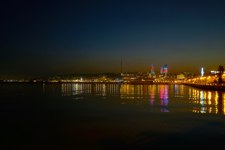 The view on beautiful illumination of Baku with its main landmark - the Flame Towers, Azerbaijan Stok Fotoğraf