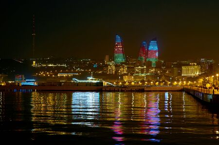 The view on bright Flame Towers that display Colors of Azerbaijan Flag, Baku. Stok Fotoğraf
