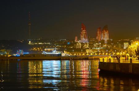 Walk along Baku Embankment is the best way to spend evening time enjoying great view on Flame Towers, Azerbaijan Stok Fotoğraf