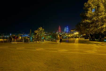 Baku Boulevard is the most beloved place among locals and tourists, due to lush greenery of park and great view on coastline of Caspian Sea, Azerbaijan Stock Photo
