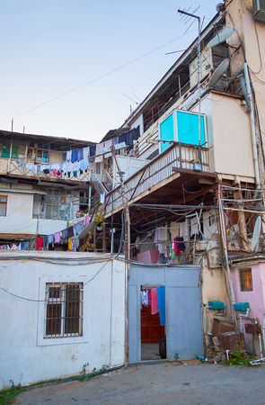 The view on old houses with drying laundry located in old residential neighborhood in Baku, Azerbaijan