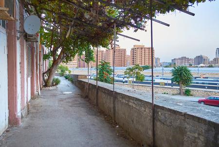 Residential shady courtyard with great view on railway station of Baku, Azerbaijan